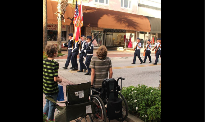 Wheelchair-Bound Teen Stands For American Flag Featured