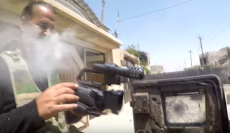 (VIDEO) Iraqi Journalists GoPro Gets Shot Off His Chest By ISIS Sniper Bullet Featured