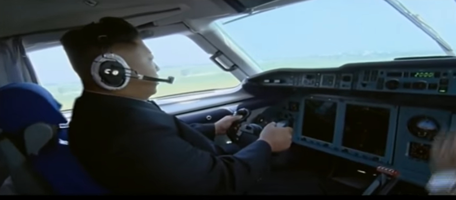 Watch North Korean Leader Kim Jong Un Pretend to Fly A Plane Featured