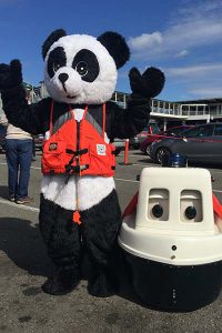 Master Chief Petty Officer Brenda Doris dresses up as PFD Panda to promote boating safety.