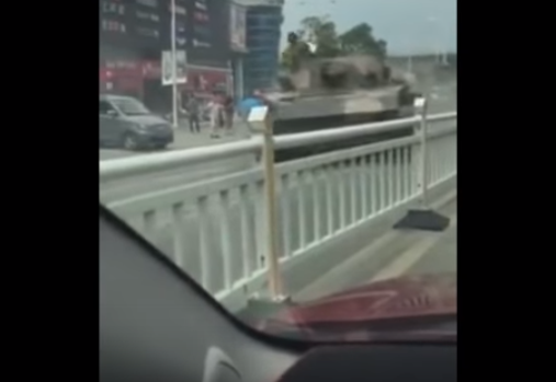 Watch A Chinese Tank Go Out Of Control & Nearly Crush A Civilian Featured
