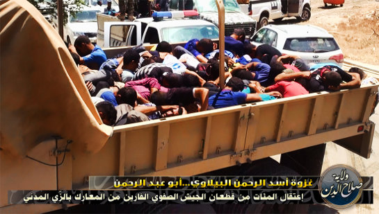 Islamists haul civilians in trucks to their slaughter.